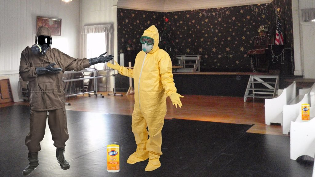 Organizers shown here demonstrating Contra Dancing in Hazmat Suits.