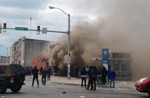 Smoke billows from a CVS Pharmacy store in Baltimore are patrons discovered all the toilet paper is gone.
