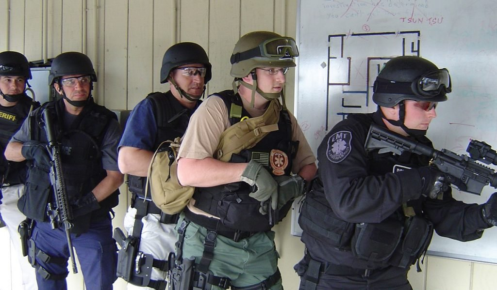 Blackwater employees seen here training with a representative of the local electronics company.