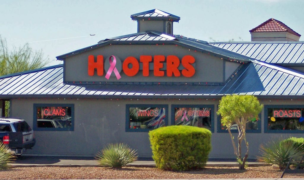 Hooters has announced the opening of the first bar and restaurant to hire only breast cancer survivors who have had one breast removed.