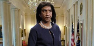 President Obama seen here in a White House corridor dressed as his wife.