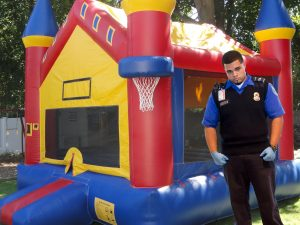 Off-duty TSA officer Charlie Banks seen here guarding a bounce house from terrorists.