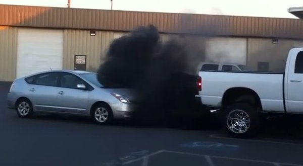 "Dustin Jayce Dickens' Dodge RAM seen here ""smoking out"" a Toyota Prius in a Grass Valley parking lot."