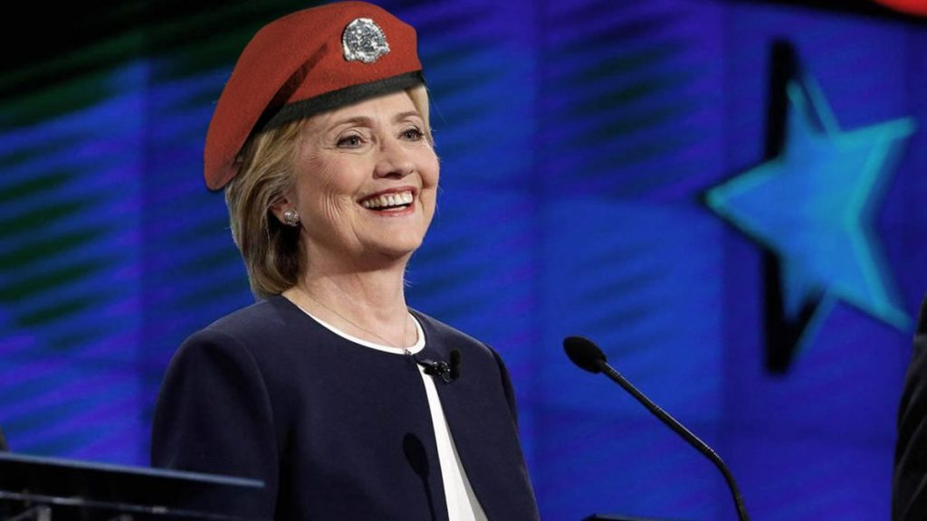 Hillary Clinton with her red beret during the Democratic debate in Des Moines, Iowa.
