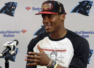 Panthers quarterback Cam Newton reveals that he is indeed black during a press conference.