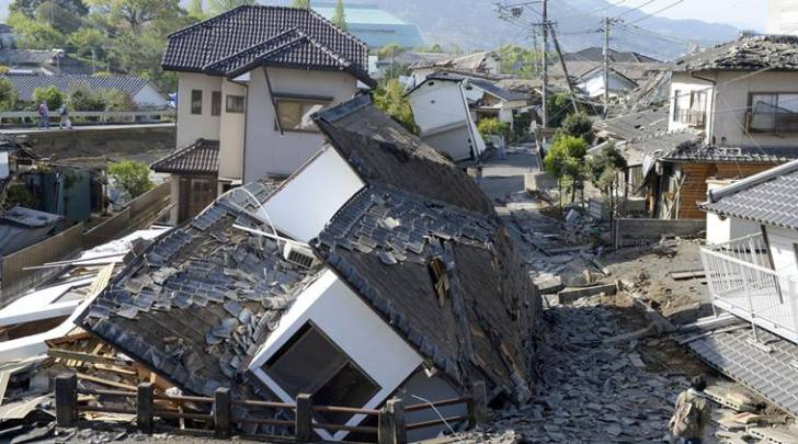 Houses are seen destroyed after an earthquake in Mashiki, Kumamoto prefecture, southern Japan Saturday, April 16, 2016. A powerful earthquake struck southern Japan early Saturday, barely 24 hours after a smaller quake hit the same region. (Ryosuke Uematsu/Kyodo News via AP) JAPAN OUT, MANDATORY CREDIT