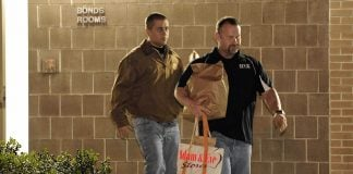 "George Zimmerman seen here walking out with his signature Adam & Eve bag filled with ""toys"""