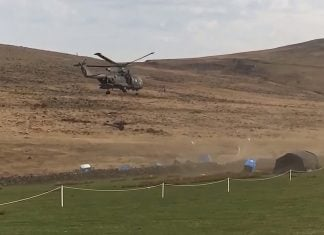 A video capture from an Internet ISIS video showing the porta potties being scattered by a Merlin helicopter.