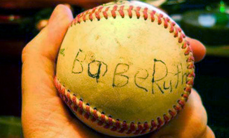Ron Jessup, owner of Ron's Sports Emporium isn't sure this signed Baseball is legitimate.