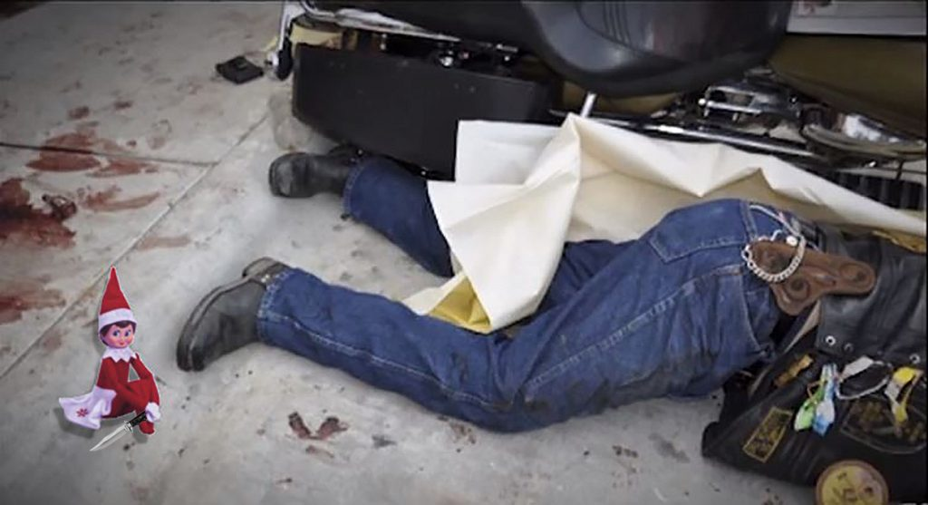 A Nevada County Food & Toy Run biker lays unconscious next to a donated Elf on the Shelf Christmas toy