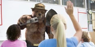 "Smokey Bear has decided to start ""packing heat"" when he visits American classrooms."