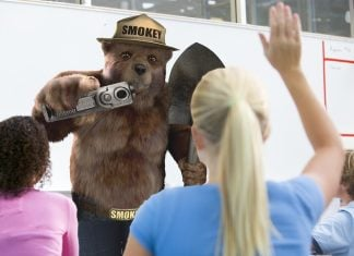 """Smokey Bear has decided to start """"packing heat"""" when he visits American classrooms."""