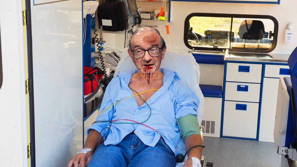 Alan Greenspan, seen here just before being transported to Mount Auburn Hospital, got into an altercation with MIT Linguist Noam Chomsky.