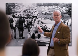 Retired teacher David Blakemore speaks with local high school students about his nightmares at the 1969 Woodstock Festival.