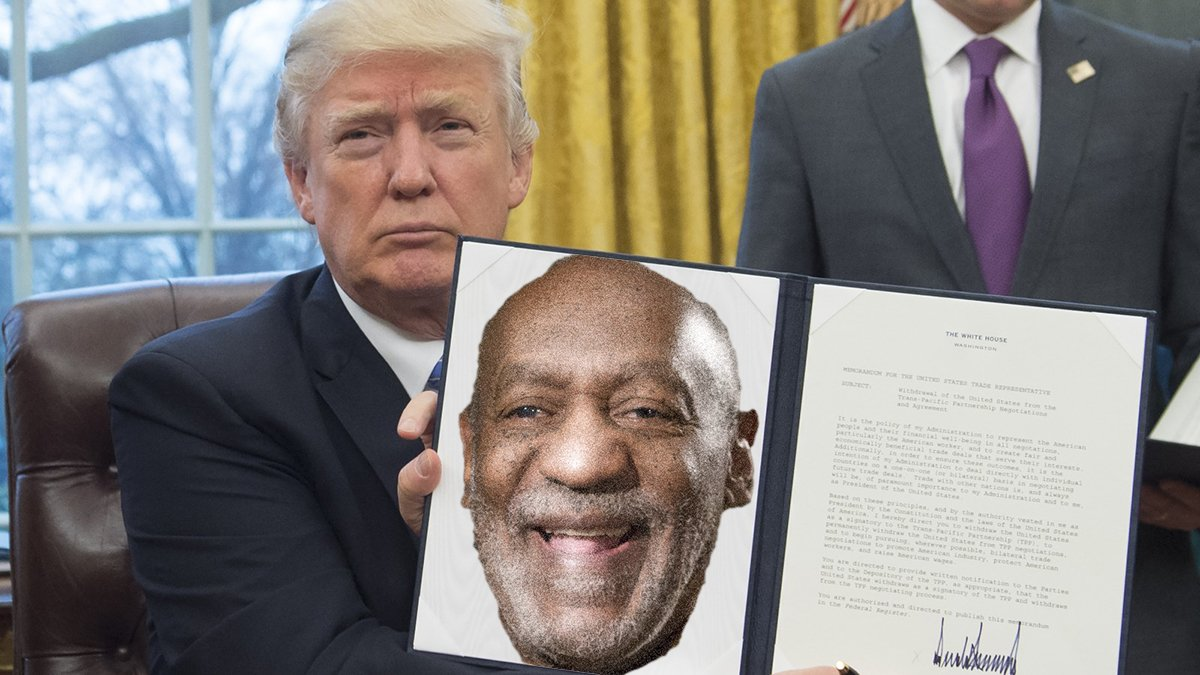 President Trump signs a Presidential pardon for Bill Cosby.