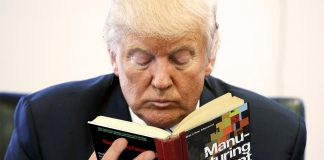 Donald Trump seen here reading the 1988 book by Noam Chomsky and Edward Herman Manufacturing Consent.