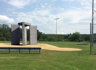 The previous stolen and assumed missing Georgia Guidestones reappeared on the Don Ball baseball field in Derry, New Hampshire earlier today.