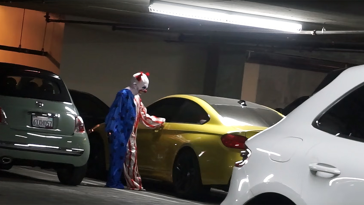 Security Cameras spot a clown finding a place to sleep in a Green Bay Wisconsin parking garage.