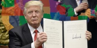 Following the Las Vegas shooting, Trump supporters took to Facebook demanding the travel ban be expanded to all 50 states. Trump seen here showing off his executive order banning Muslims from entering the country.