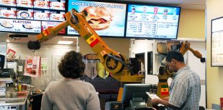 """A new Burger King restaurants being operated by two """"automated staff"""" in Miami, FL."""